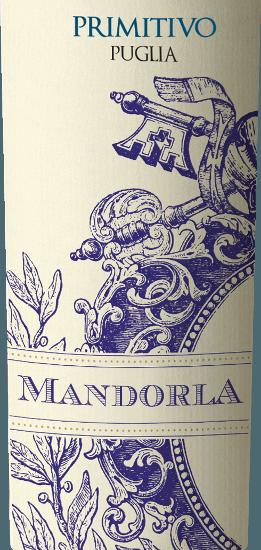El Primitivo de Mandorla es un vino tinto fino, afrutado y suave procedente de la región vinícola italiana de Apulia. Este vino se presenta con un color rojo potente y brillante. Aromas afrutados de bayas rojas (frambuesas), cerezas negras coordinados con una fina nota de pimienta picante y matices de frutos secos llenan la nariz. En el paladar, este vino tinto italiano es maravillosamente redondo gracias a sus suaves taninos. El sabor jugoso y potente revela bayas oscuras (moras y grosellas negras) y da paso a un final largo y agradable. En general, el Primitivo de Mandorla es una gota armoniosa y compleja. Vinificación del Mandorla Primitivo Puglia Tras la cuidadosa vendimia de las uvas Primitivo de la bodega Mandorla, las uvas se despalillan primero, se trituran y el mosto resultante se fermenta en depósitos de acero inoxidable bajo control de temperatura. El mosto es finalmente prensado y este vino se almacena en parte en depósitos de acero y en parte en grandes barriles de madera, donde este tinto se redondea y finalmente se embotella. Después nos llega el Mandorla Primitivo en Alemania. Recomendación de comida para el Primitivo Mandorla Recomendamos este vino tinto seco de Italia para los antipasti, la pizza, la pasta, los platos de carne fuerte (también a la parrilla) y los quesos curados.